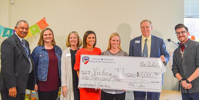 Victoria Johnson receives an award